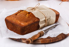 Pumpkin bread loaf over white wooden background Royalty Free Stock Image