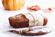 Pumpkin bread loaf over white wooden background. Selective focus, shallow Depth of Field royalty free stock images