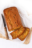 Pumpkin bread loaf over white wooden background Stock Photos