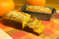 Pumpkin bread loaf sliced with pumpkins Stock Image