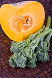 Pumpkin And Broccolini Stock Photography