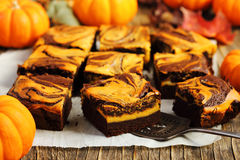 Pumpkin brownies. On wooden table Royalty Free Stock Images