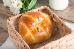 Pumpkin bun topping with pumpkin seeds. Pumpkin bun topping with pumpkin seeds in the basket stock image