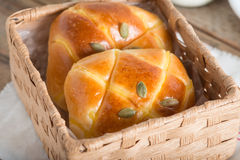 Pumpkin bun topping with pumpkin seeds in the basket. Pumpkin bun topping with pumpkin seeds in the basket stock images
