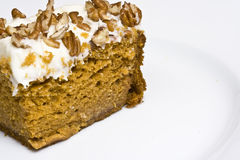 Pumpkin cake. Slice of pumpkin cake with cream cheese frosting, could pass for carrot cake though Stock Images