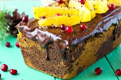 Pumpkin cake with chocolate and oranges. Pumpkin cupcake with chocolate, cranberries and oranges Stock Photo