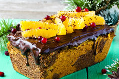 Pumpkin cake with chocolate and oranges. Pumpkin cupcake with chocolate, cranberries and oranges Stock Photography