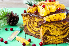 Pumpkin cake with chocolate and oranges. Pumpkin cupcake with chocolate, cranberries and oranges Royalty Free Stock Photography