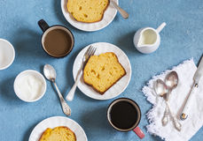Pumpkin cake and coffee on a blue background. Delicious dessert, breakfast or snack Stock Image