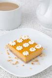 Pumpkin cake, decorated with flowers made of whipped cream and n Stock Photos