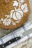 Pumpkin cake on glass plate and knife Royalty Free Stock Photo
