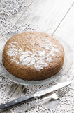 Pumpkin cake on glass plate and lace napking. Pumpkin cake decorated with pattern. From the series Pumpkin cake Royalty Free Stock Image