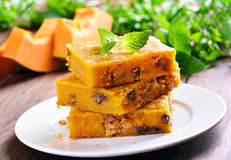 Pumpkin cake with nuts. On white plate Royalty Free Stock Photography