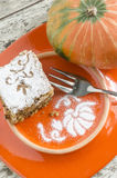 Pumpkin cake on orange plate Royalty Free Stock Images