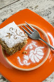Pumpkin cake on orange plate and fork Royalty Free Stock Photo
