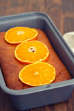 Pumpkin cake with orange on white dish Stock Photo