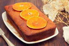 Pumpkin cake with orange on white dish Royalty Free Stock Images