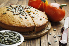 Pumpkin cake. With seeds on a wooden table Stock Images