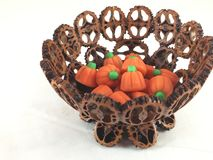 Pumpkin candies in nut shell bowl Stock Images