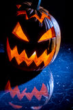 Pumpkin with candle lighted for halloween stock photos