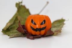 Pumpkin candle Stock Photos