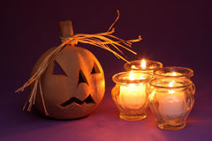Pumpkin and candles Stock Photos