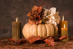 Pumpkin and candles Royalty Free Stock Images