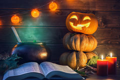 Pumpkin, candles, spell book and potion royalty free stock photo