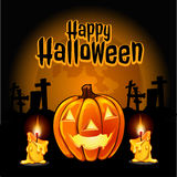 Pumpkin and candles to the cemetery on Halloween Royalty Free Stock Image