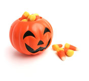 Pumpkin And Candy Corn. A plastic pumpkin filled with candy corn Stock Photography