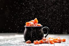 Pumpkin candy is sprinkled with sugar powder stock images