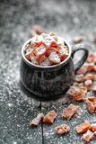 Pumpkin candy is sprinkled with sugar powder royalty free stock images