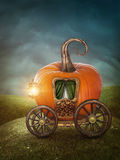 Pumpkin carriage. On the meadow Royalty Free Stock Photos