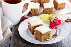Pumpkin and carrot cake with cream cheese. And orange glaze stock images