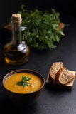 Pumpkin, carrot and lentil soup, bread and olive oil Stock Photo