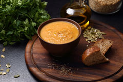 Pumpkin, carrot and lentil soup, bread and olive oil Stock Image