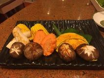 Pumpkin, carrot and mushroom. In black tray royalty free stock photos