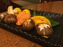 Pumpkin, carrot and mushroom. In black tray stock photography