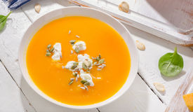 Pumpkin and carrot soup stock images
