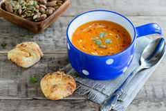 Pumpkin and carrot soup with nuts and bread buns Royalty Free Stock Image