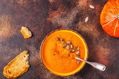 Pumpkin and carrot soup served with seeds stock images