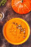 Pumpkin and carrot soup served with seeds stock photography