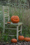 Pumpkin carved into traditional Halloween Jack O'Lantern Stock Photos