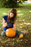 Pumpkin Carving. Preteen girl carving a pumpkin for Halloween Stock Images
