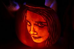 Pumpkin carving of a girl`s face. Detailed pumpkin carving of a young girl`s face, created by the photographer stock photos