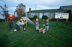 Pumpkin Characters Camping on Front Lawn of House, Maine Royalty Free Stock Photography