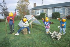 Pumpkin Characters Camping on Front Lawn of House, Maine Royalty Free Stock Images