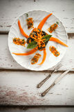 Pumpkin Chard Gnocchi Moulded. Overhead shot of plate with moulded bicolor gnocchi with pumpkin and chard cream, decorated with fresh pumpkin and basil leaves Stock Photography