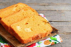 Pumpkin cheese bread slices. Pumpkin bread with cheese filling on a wooden board. Healthy and tasty bread recipe. Closeup Stock Images