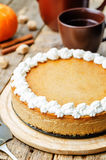 Pumpkin cheesecake decorated with whipped cream Stock Photography